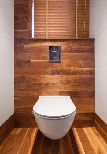 Wooden wall and floor in toilet in the residence